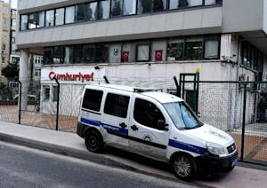 A police car stationed outside the headquarters of…