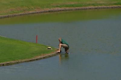 Watch an LPGA fan go pond-diving for hat, lose beer, face-plant in Hawaii