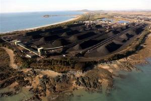 Mounds of coal can be seen along the coastline of Queensland at the port of Hay Point