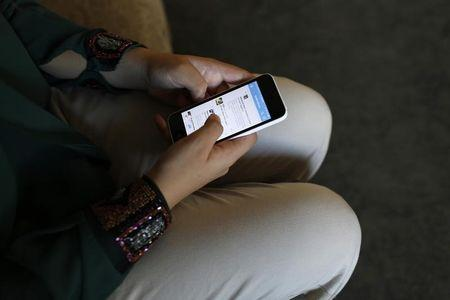 Baker uses phone to tweet in her family's home in Gaza City