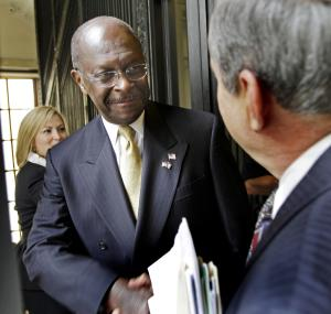 FILE - In this Oct. 12, 2011 file photo, Republican presidential candidate, businessman Herman Cain is greeted by lawmakers at the statehouse in Concord, N.H. One way surging GOP presidential candidate Herman Cain has distinguished himself from his rivals is by calling for an alternative to Social Security _ a private retirement plan modeled on one instituted a generation ago in Chile. But many Chileans are unhappy with the system they've got.  (AP Photo/Jim Cole)