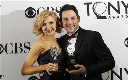 Nina Arianda (L) and Steve Kazee pose backstage with their awards during the American Theatre Wing's 66th annual Tony Awards in New York