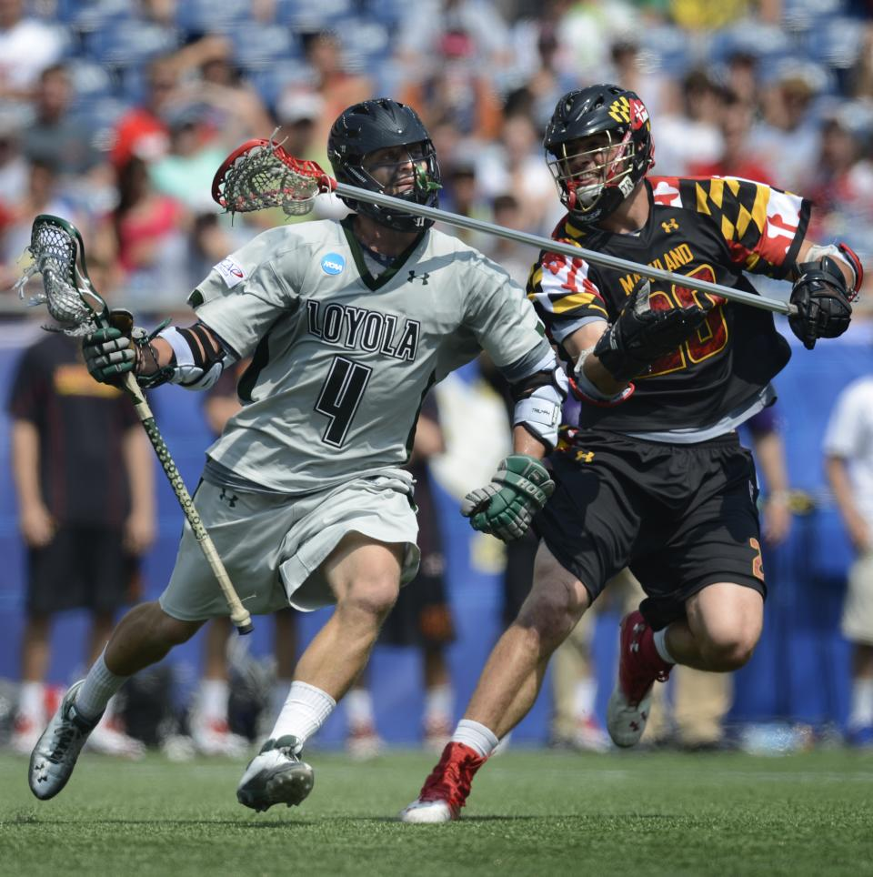 Loyola's Mike Sawyer (4) works his way past Maryland's Billy Gribbin, right during the third quarter of their Division I NCAA men's lacrosse championship game at Gillette Stadium in Foxborough, Mass., Monday, May 28, 2012. Loyola won 9-3.  (AP Photo/Gretchen Ertl)
