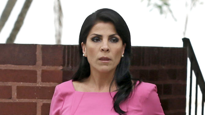 "FILE - In this Nov 13, 2012 file photo Jill Kelley leaves her home in Tampa, Fla. The Tampa socialite at the center of a scandal involving Gen. David Petraeus has hired a top Washington attorney and seems to be trying to change the narrative about her friendship with the general, her past and her role as an ""honorary consul"" to the country of South Korea. On Tuesday, Nov. 27, 2012, Kelley's attorney Abbe Lowell released emails, telephone recordings and other material that he and Kelley say proves she never tried to exploit her friendship with Petraeus. (AP Photo/Chris O'Meara, File)"