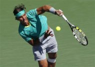 Rafael Nadal of Spain returns a volley at the net against Tomas Berdych of the Czech Republic during their men's singles semifinal match at the BNP Paribas Open ATP tennis tournament in Indian Wells, California, March 16, 2013. REUTERS/Danny Moloshok