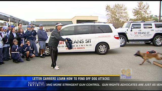 Local postal workers learn how to fend off dog attacks