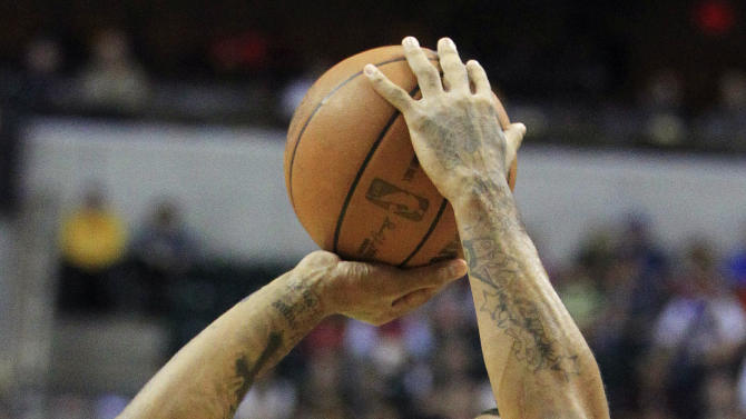 Chicago Bulls' Derrick Rose shoots during the first half of an NBA basketball game against the Indiana Pacers,  Wednesday, April 25, 2012, in Indianapolis. (AP Photo/Darron Cummings)