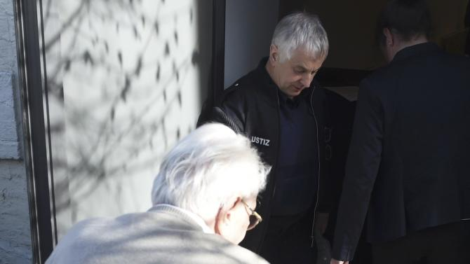 Former bookkeeper at Auschwitz Groening arrives for trial in Luneburg