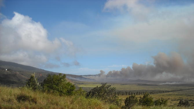 FILE - In this Nov. 18, 2008 file photo courtesy of the The Lanai Times, a brush fire burns on the island of Lanai, Hawaii. Oracle Corp. CEO Larry Ellison has reached a deal to buy 98 percent of the island of Lanai from its current owner, Hawaii Gov. Neil Abercrombie said Wednesday, June 20, 2012. (AP Photo/The Lanai Times, Sharon Owens, File)
