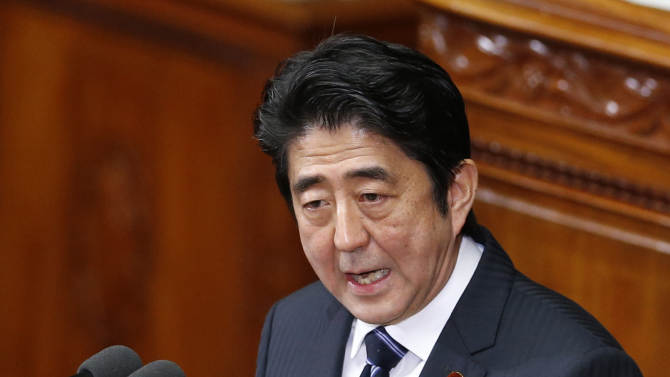 """Japanese Prime Minister Shinzo Abe delivers his policy speech during an opening session at the lower house of parliament in Tokyo, Monday, Jan. 28, 2013. Abe whose government faces stiff challenges in reviving the economy and managing an escalating dispute with China over an island chain in the East China Sea said """"Let us have strong determination to regain a powerful economy."""" Abe also said, """"We will take every measure to promote and manage and we will give our best efforts to guard the remote islands at the borders."""" (AP Photo/Koji Sasahara)"""