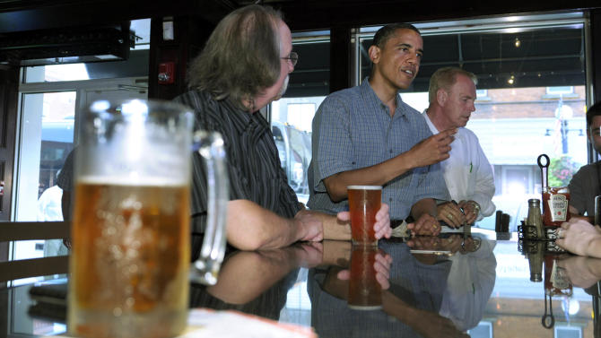 President Barack Obama talks with patrons as he stops for a beer at Ziggy's Pub and Restaurant in Amherst, Ohio, Thursday, July 5, 2012. Obama is on a two-day bus trip through Ohio and Pennsylvania. At right is former Ohio Gov. Ted Strickland.  (AP Photo/Susan Walsh)