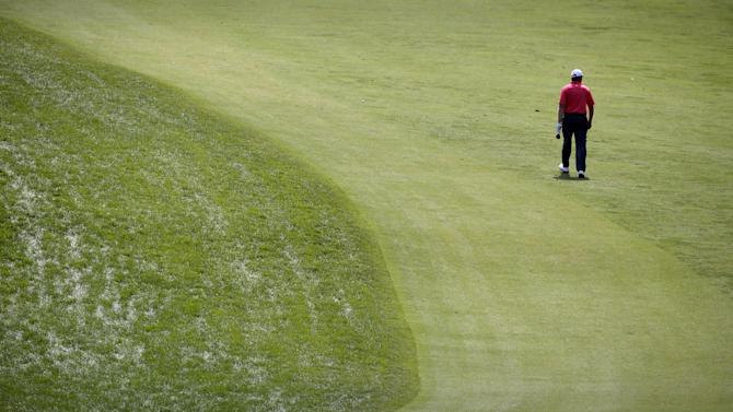 Ernie Els, of South Africa, walks down the first hole during practice for the U.S. Open golf tournament at Merion Golf Club, Wednesday, June 12, 2013, in Ardmore, Pa. (AP Photo/Charlie Riedel)