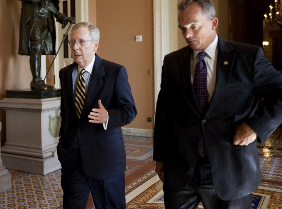 Senate Minority Leader Mitch McConnell of Ky., left, walks with Secretary for the Minority David Schiappa on Capitol Hill in Washington, Wednesday, July 27, 2011.  (AP Photo/Evan Vucci)