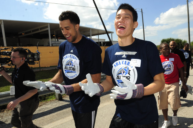 New York Knicks players Jeremy Lin, right, and Landry Fields laugh as they prepare to work as part of the NBA Cares All-Star Day of Service on Feb 24, 2012 in Orlando, Fla.  (Scott A. Miller/AP Images