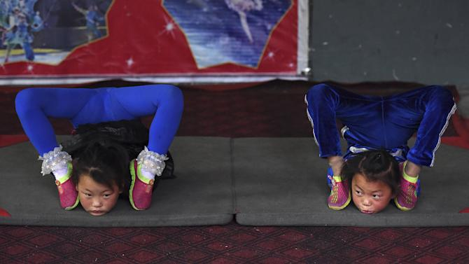 Students practice at an acrobatic school in Sanwang village
