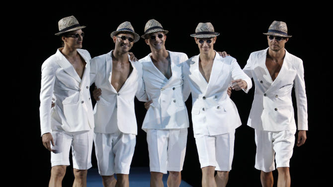 Models wear creations of Giorgio Armani, from the men's Spring-Summer 2013 collection, part of the Milan Fashion Week, unveiled in Milan, Italy, Tuesday, June 26, 2012. (AP Photo/Luca Bruno)