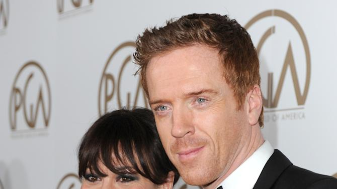 Helen McCrory and Damian Lewis arrive at the 24th Annual Producers Guild (PGA) Awards at the Beverly Hilton Hotel on Saturday Jan. 26, 2013, in Beverly Hills, Calif. (Photo by Jordan Strauss/Invision for The Producers Guild/AP Images)