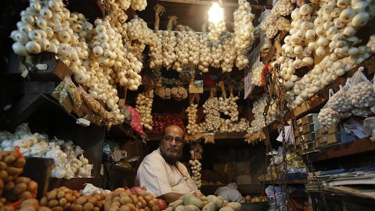 Vendor waits for customers at his stall at wholesale food market in Mumbai
