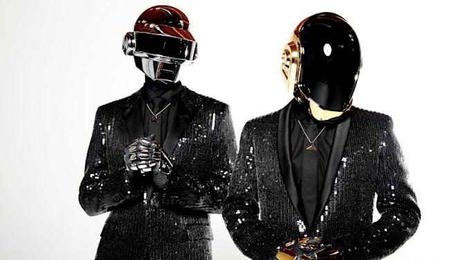 """FILE - In this April 17, 2013 file photo, Thomas Bangalter, left, and Guy-Manuel de Homem-Christo, from the music group, Daft Punk, pose for a portrait in Los Angeles. Daft Punk has five nominations at Sunday, Jan. 26, 2014 Grammy Awards, including album of the year for """"Random Access Memories"""" and record of the year for """"Get Lucky."""" (Photo by Matt Sayles/Invision/AP, File)"""