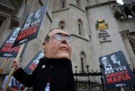 Protesters from the Avaaz group demonstrate outside London's High Court. Former News International executive chairman James Murdoch is giving testimony at the court as part the British inquiry into press standards set up after the tabloid phone-hacking row