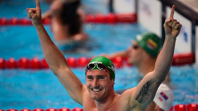 South Africa's Cameron van der Burgh celebrates after competing in the preliminary heats of the men's 50m breaststrock event at the FINA World Championships in Kazan on August 4, 2015