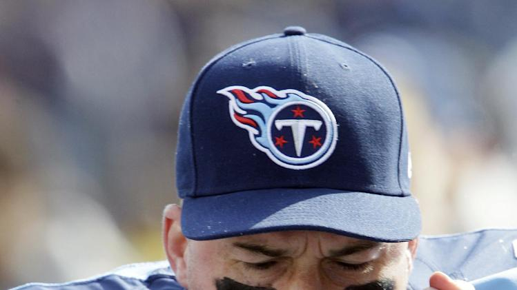 Tennessee Titans quarterback Matt Hasselbeck screams on the sideline during the first quarter of an NFL football game against the Chicago Bears on Sunday, Nov. 4, 2012, in Nashville, Tenn. (AP Photo/Wade Payne)