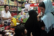 Iranian women shop at a grocery store in Tehran on September 30, 2012, amid draconian Western economic sanctions. Exiled former Iranian lawmakers on Thursday proposed a compromise to avert conflict over Tehran's nuclear program, calling for an end to sensitive uranium enrichment and an easing of US-led sanctions