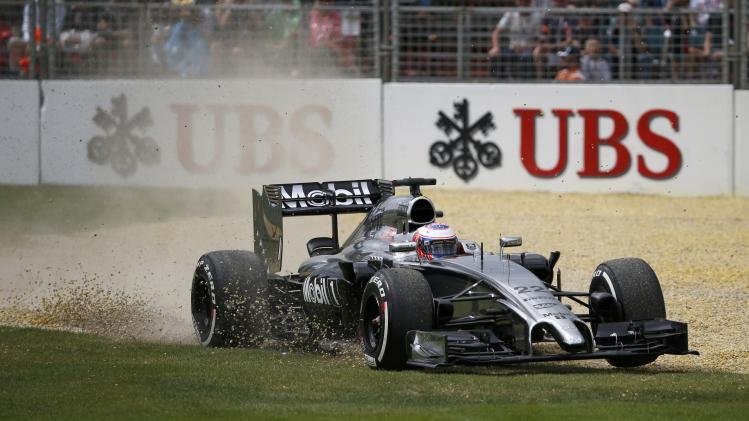 McLaren Formula One driver Button of Britain drives to gravel during the third practice session of the Australian F1 Grand Prix in Melbourne