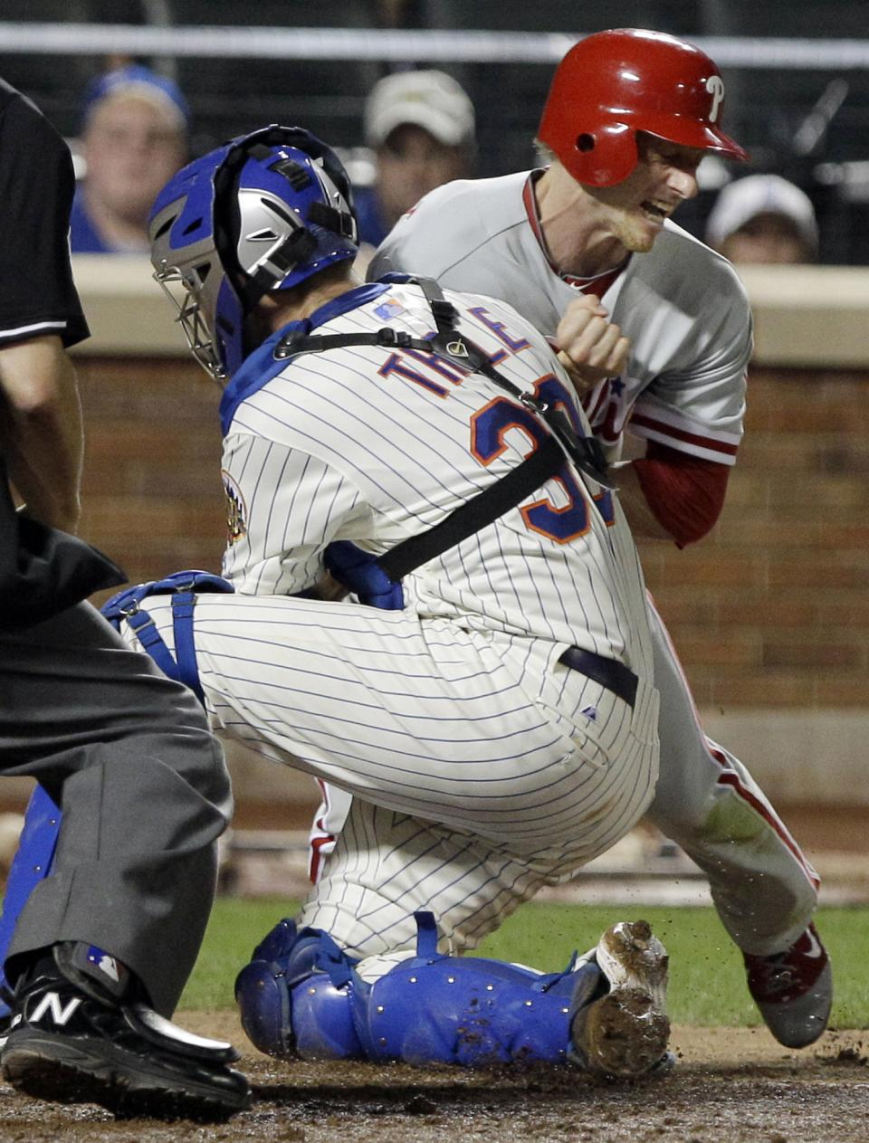 Philadelphia Phillies' Mike Fontenot is tagged out at home plate by New York Mets catcher Josh Thole during the eighth inning of a baseball game, Thursday, July 5, 2012, in New York. (AP Photo/Frank Franklin II)