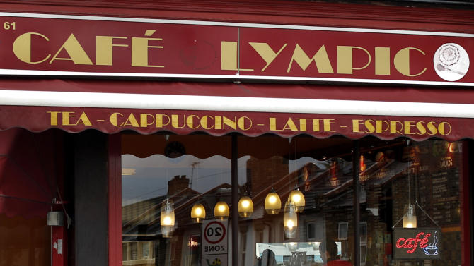 """In this Friday, April 27, 2012 photo the facade of the Cafe Lympic is seen in Stratford, east London. One day, the small espresso shop near the site of the London Games was the """"Olympic"""" cafe. The next day, it was the """"Lympic."""" So where did the """"O"""" go? The manager won't say. But it's more than likely the small business became another casualty in the battle against guerrilla marketers _ advertisers who try to associate their products with an event without paying to be sponsors. Protecting the Olympic brand is always a big job, and never more so than this year. Olympic organizers say the increasing sophistication of guerrilla marketers and the rise of social media are putting the five rings under assault in ways barely envisioned a decade ago.   (AP Photo/Matt Dunham)"""