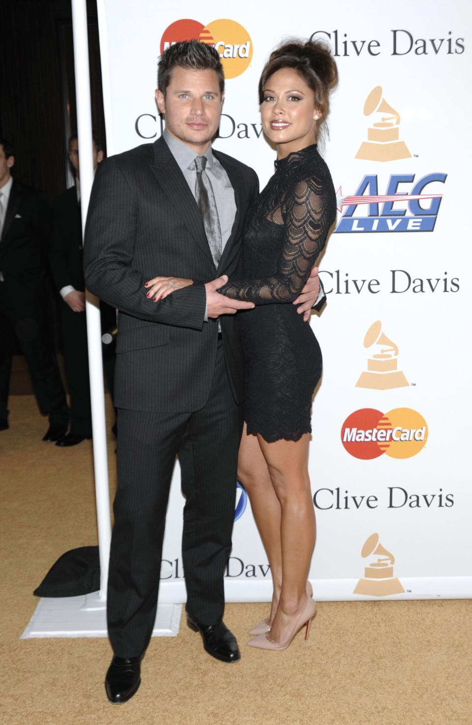 FILE - This Feb. 12, 2011 file photo shows Nick Lachey, left, and Vanessa Lachey arriving at the Pre-Grammy Gala & Salute to Industry Icons with Clive Davis honoring David Geffen in Beverly Hills, Calif. (AP Photo/Dan Steinberg, file)