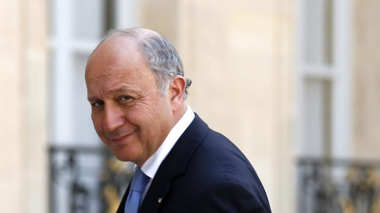 French Foreign Affairs minister Laurent Fabius arrives to attend a meeting at the Elysee Palace in Paris after Air Algerie flight AH 5017 crashed on Thursday en route from Ouagadougou in Burkina Faso to Algiers