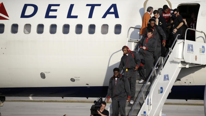 Alabama players deplane after arriving at Miami International Airport, Wednesday, Jan. 2, 2013 in Miami.  Alabama takes on Notre Dame in the BCS national championship NCAA college football game next Monday in Miami. (AP Photo/Wilfredo Lee)