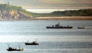 This file photo shows a North Korean navy patrol boat amongst North Korean fishing boats, pictured in 2009, in the disputed waters of the Yellow Sea. Seoul's top official in cross-border ties warned on Monday that recent territorial violations by N.Korean fishing boats might be a deliberate ploy by Pyongyang to provoke the South