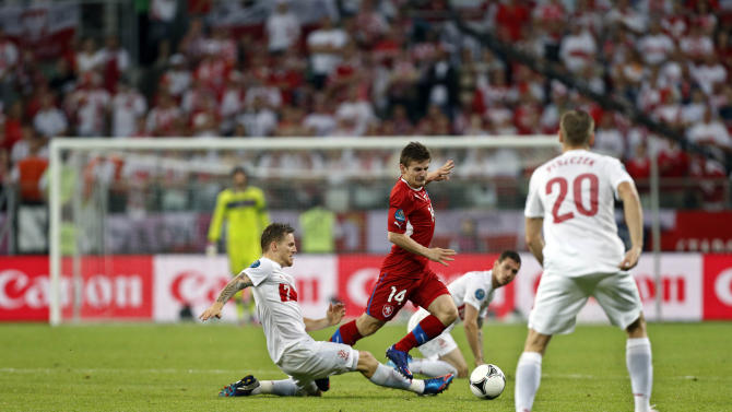 Czech Republic's Vaclav Pilar, right, goes for the ball by Poland's Eugen Polanski during the Euro 2012 soccer championship Group A match between Czech Republic and Poland in Wroclaw, Poland, Saturday, June 16, 2012. (AP Photo/Jon Super)