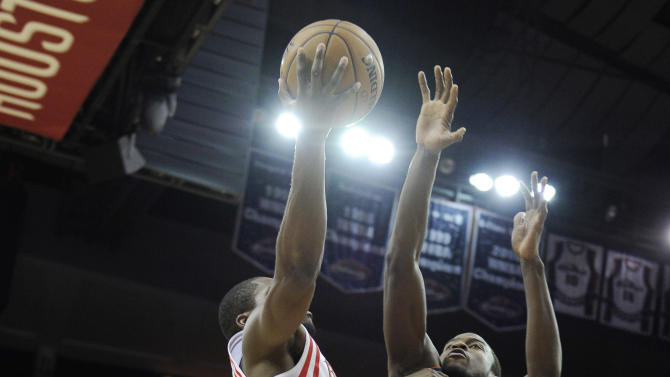 Houston Rockets' Toney Douglas, left, and Charlotte Bobcats' Michael Kidd-Gilchrist (14) collide under the basket in the second half of an NBA basketball game on Saturday, Feb. 2, 2013, in Houston. Kidd-Gilchrist took a hard fall and left the court on a stretcher. (AP Photo/Pat Sullivan)