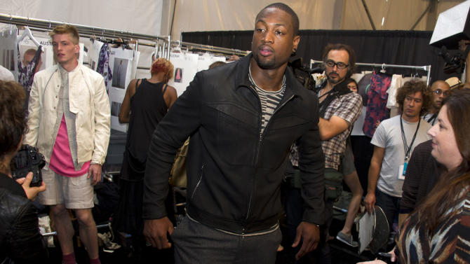 FILE - In this Sept. 8, 2011 file photo, Miami Heat basketball player Dwyane Wade visits backstage at the Richard Chai Spring 2012 fashion show during Mercedes-Benz Fashion Week in New York. The Miami Heat star says while he always was a fan of fine dressing, it wasn't until the former commissioner of the league instituted a dress code that he started taking more interest in what he would wear off the court. Now Wade is considered among the more fashion-forward stars in a league where players dress to impress.  (AP Photo/Charles Sykes, File)