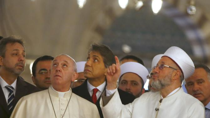 Pope Francis listens to Rahmi Yaran Mufti of Istanbul during visit to Hagia Sophia in Istanbul