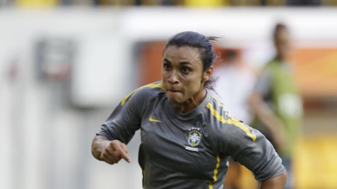 Brazil's Marta dribbles during a training session in preparation for a quarterfinal match against the United States during the Women's Soccer World Cup in Dresden, Germany, Saturday, July 9, 2011. (AP Photo/Marcio Jose Sanchez)