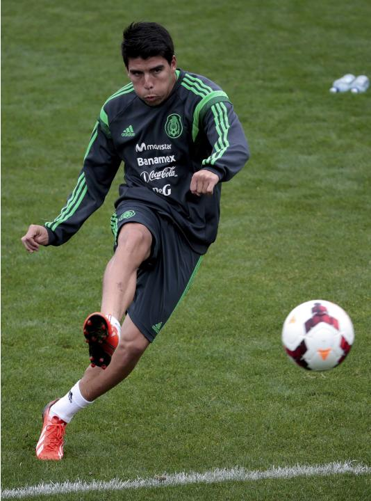 Mexico's Luis Angel Mendoza kicks a ball at a team training session for their 2014 World Cup qualifying playoff second leg soccer match against New Zealand in Wellington