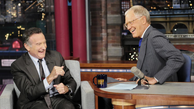 "In this Wednesday, Sept. 25, 2013 photo provided by CBS, actor Robin Williams, left, joins host David Letterman on the set of the ""Late Show with David Letterman,"" in New York. CBS says Letterman has signed a contract extension to remain host of the ""Late Show"" into 2015. (AP Photo/John Paul Filo) MANDATORY CREDIT; NO ARCHIVE; NO SALES; NORTH AMERICAN USE ONLY"
