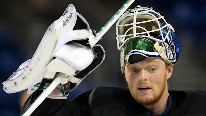 File-This Jan. 8, 2013 file photo shows Vancouver Canucks goalie Cory Schneider leaving the ice after an informal hockey practice at the University of British Columbia in Vancouver, British Columbia. The New Jersey Devils have acquired Schneider from the Vancouver Canucks for the ninth pick in the NHL draft (AP Photo/The Canadian Press, Darryl Dyck)