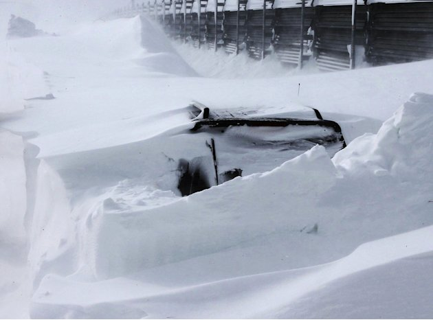 In this photo taken Sunday, March 3, 2013, a vehicle of Kazuyo Miyashita is buried in the snow along a road in Nakashibetsu, Hokkaido, northern Japan. Kyodo news service says Miyashita and her three c