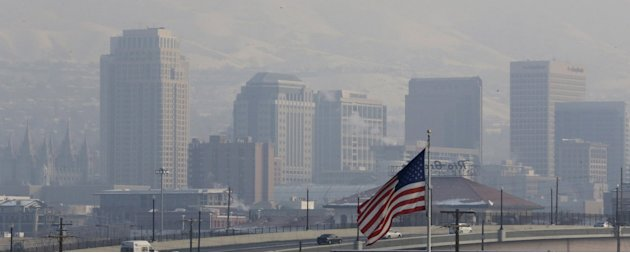 This Jan. 4, 2013, file photo, shows the haze from an inversion hanging over downtown Salt Lake City. The geography that makes Utah one of the world's most beautiful places also brings the nation's di