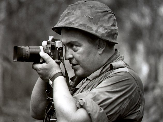 FILE - In this 1967 file photo Associated Press photographer Horst Faas works in Vietnam. Faas, a prize-winning combat photographer who carved out new standards for covering war with a camera and became one of the world&#39;s legendary photojournalists in nearly half a century with The Associated Press, died Thursday May 10, 2012. He was 79. (AP Photo)