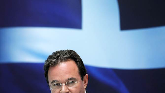 FILE - In this July 5, 2010 file photo, Greek Finance Minister George Papaconstantinou speaks during a news conference in Athens. Three relatives of a Greek former Cabinet minister are missing from a list of Greeks with Swiss bank accounts that authorities are using to investigate possible tax evasion, court officials said Friday, Dec. 28, 2012. The ex-minister was not formally identified, but Greek media widely reported it to be former finance minister George Papaconstantinou, who had originally obtained the list from France in 2010. According to the leaks, two of his cousins and their husbands were involved in the accounts. (AP Photo/Thanassis Stavrakis, File)