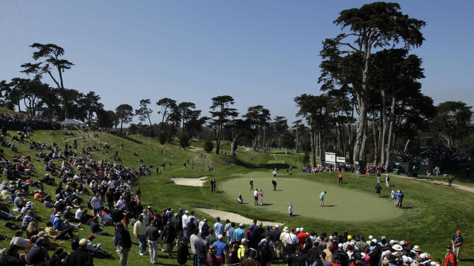 Players putt on the eighth green during a practice round for the U.S. Open Championship golf tournament Wednesday, June 13, 2012, at The Olympic Club in San Francisco. (AP Photo/Ben Margot)