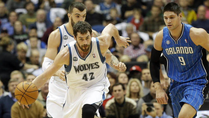 Love carries Wolves past Magic, 120-115