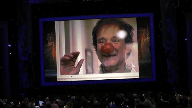 Robin Williams is shown on a large screen during the In Memoriam segment at the 21st annual Screen Actors Guild Awards in Los Angeles