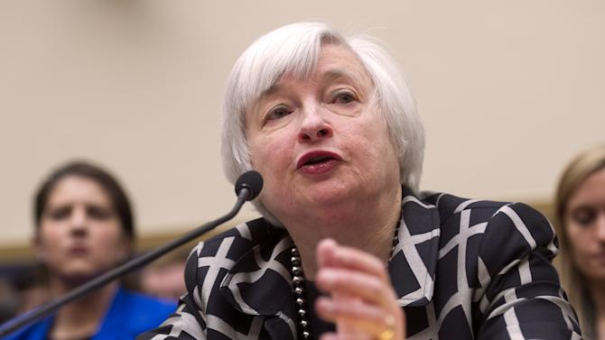 Yellen rebuffs Fed critics and pleases investors